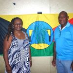 Emelda Davis & Roy Eggmolesse gifting ASSI flag to ASSIPJ